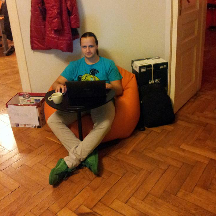 A Bean Bag, A Laptop Table And A Cardboard Box. Flying Office